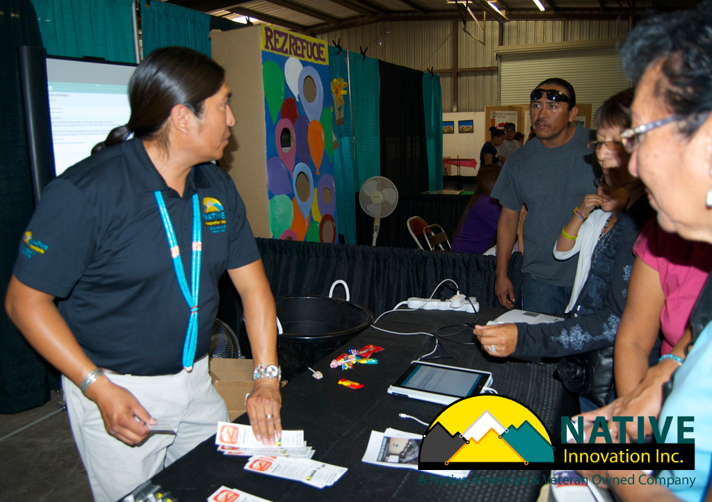 "Kialo Winters presents the Diné Bizaad app for iPhone®, iPad® & iPod touch® at the 68th Annual Navajo Nation Fair. He guaranteed everyone would be high-fiving the Native Innovation crew after they saw what features were in the app. A father asks, ""Did you just say FREE?"" YES FREE!! EVERYONE HIGH-FIVED OUR NATIVE INNOVATION CREW."
